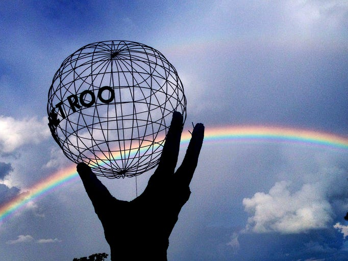 A rainbow is visible over the 2014 Bonnaroo Music Festival in Manchester, Tenn.