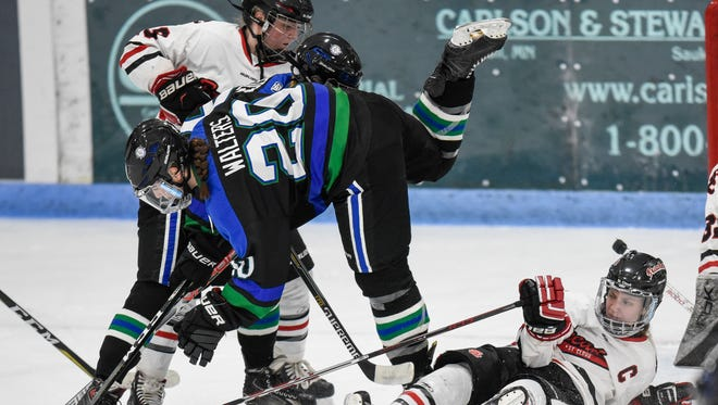 Players collide in front of the St. Cloud Icebreakers goal during the first half of a game between the Icebreakers and the Sartell/Sauk Rapids Storm'N Sabres Saturday, Feb. 10, at the MAC in St. Cloud.