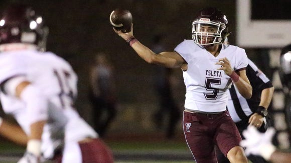 Ysleta quarterback Damian Solis throws to a receiver
