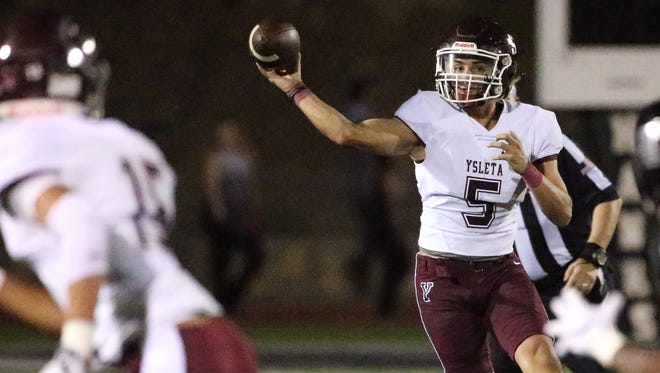 Ysleta quarterback Damian Solis throws to a receiver Friday night.
