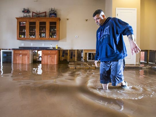 Man moving through flooded living room