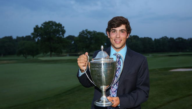 White Plains resident Bobby DiForio poses at Baltusrol with the Carter Cup, which he won by a stroke Wednesday.