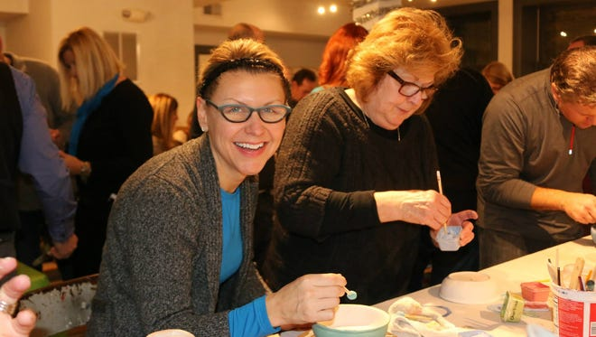 Nicole LeClaire and her mom, Coreen Loomis, paint ceramic bowls for the annual Empty Bowls event organized through Assumption Greek Orthodox Church in St. Clair Shores to benefit Cass Community Social Services.