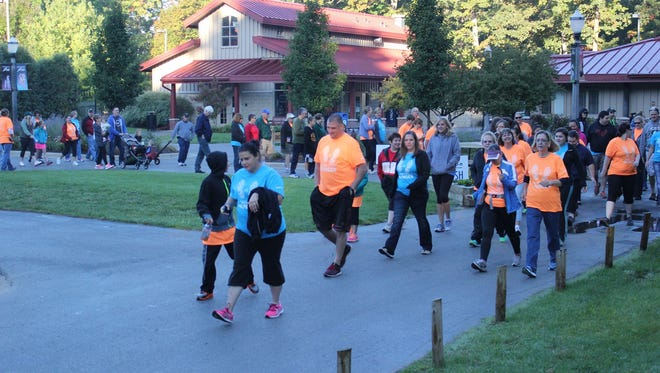 Participants walk around Potter Park Zoo in the 2014 'Race to Million' event to benefit the Greater Lansing Food Bank.