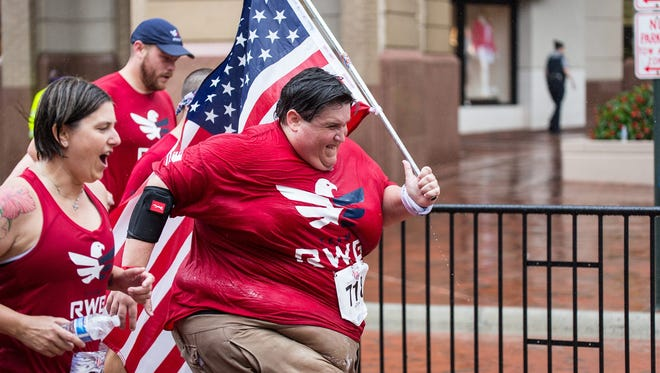Derek Mitchell, 35, sprints toward the finish line at the Firecracker 5K in Reston, Va. on July 4, 2015. Mitchell has committed to running at least one 5K each month this year as part of his effort to live a healthier, more active lifestyle.