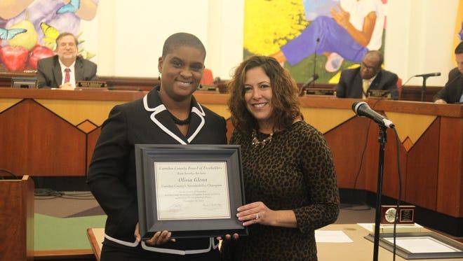 Olivia Glenn of New Jersey Conservation Foundation, left, received a Sustainability Award on Nov. 12 from Camden County Freeholder Michelle Gentek-Mayer.