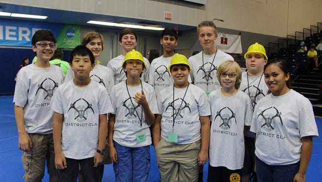 Creative Learning Academy middle school robotics team poses after the University of West Florida BEST robotics event.