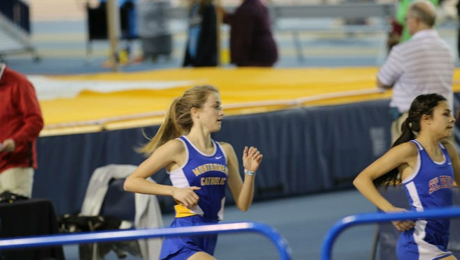Amaris Tyynismaa of Catholic, left, hangs on behind St. Paul's Isabel Valenzuela in the girls 4A-5A two-mile race. Tyynismaa won the race in 11:21.88 at the AHSAA state indoor track meet on Friday at the CrossPlex in Birmingham.
