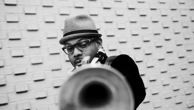 "Michigan State University professor of jazz trumpet Etienne Charles plays on Marcus Miller's Grammy-nominated ""Afrodeezia."""