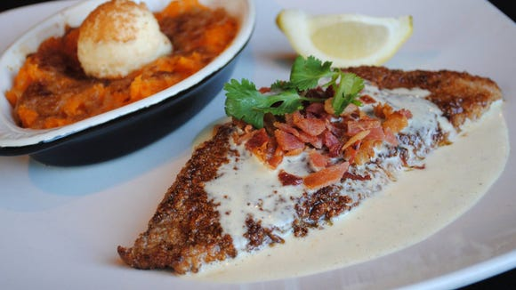 The bacon and pecan crusted redfish with orange beurre
