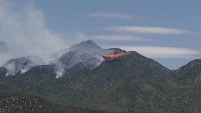 Fire crews drop retardant near a wildfire in the Pine Valley Wilderness. The Saddle Fire has been burning for a week above the Washington County community of Pine Valley.