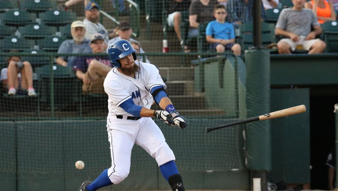 Cameron Monger of the Canaries loses his bat during Friday night's game against the Laredo Lemurs at the Birdcage.