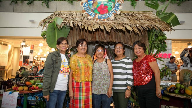 Representatives of the Western Visayas College of Science and Technology Guam Chapter, a member organization of the Filipino Community of Guam stand in front of their cultural presentation at the FCG's Pista Sa Nayon celebration on June 25 at the Micronesia Mall Center Court.