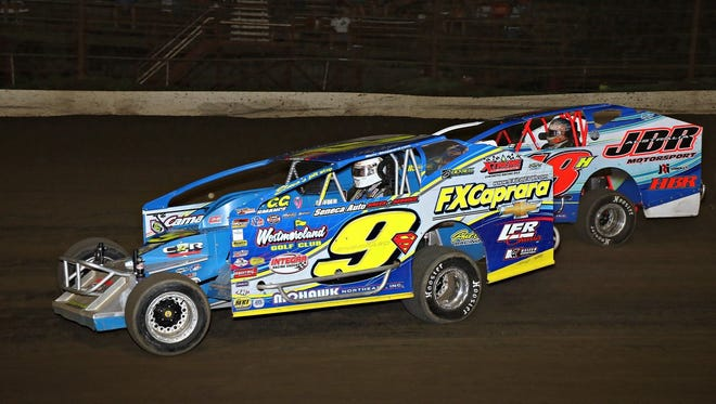 Matt Sheppard (9) holds off a competitor during his win in the Big Block Modified Super DIRTCar Series Traffic Jam at Grandview Speedway last week.