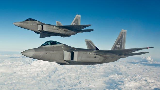 A pair of F-22 raptors.