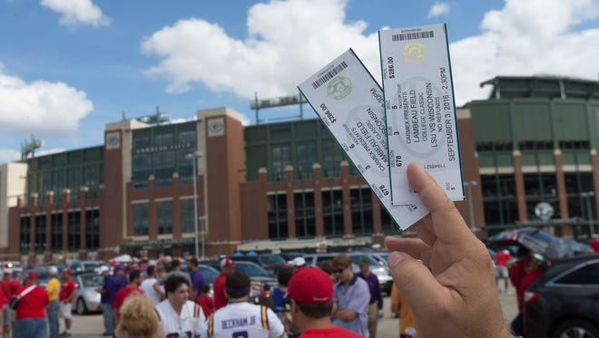An LSU fan tries to sell two tickets.