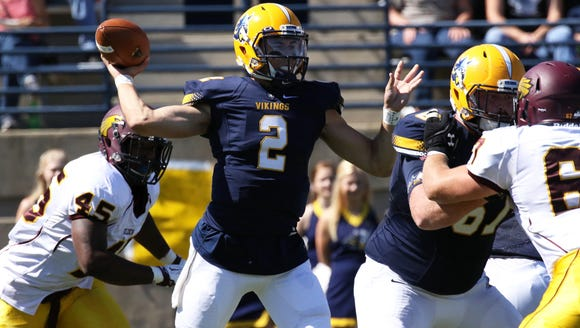 Augustana quarterback Trey Heid passes the ball during