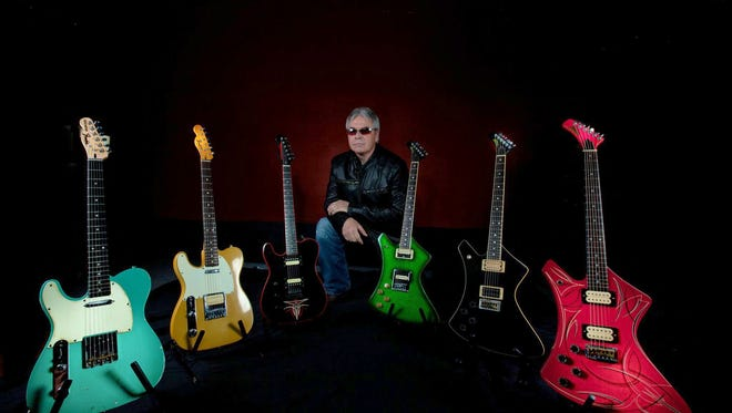 Mark Goodman, promoter of the Southern Ohio Guitar Show, is pictured with his collection of electric guitars. The 14th annual event is slated for Sept. 25 at the Ross County Fairgrounds.