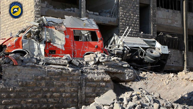 In this photo provided by the Syrian Civil Defense group known as the White Helmets, destroyed ambulances are seen outside the Syrian Civil Defense main center after airstrikes in Ansari neighborhood in the rebel-held part of eastern Aleppo, Syria, on Sept. 23, 2016.