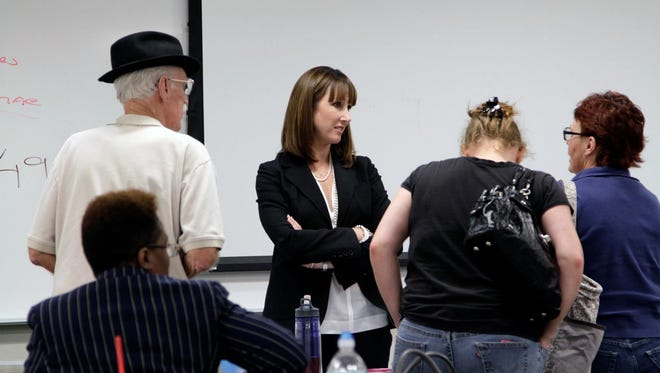 Levin Papantonio shareholder Rachael Gilmer (center) with a group of students at the People's Law School, a free program provided by the Levin Papantonio Law Firm to teach citizens about their tights and the law.