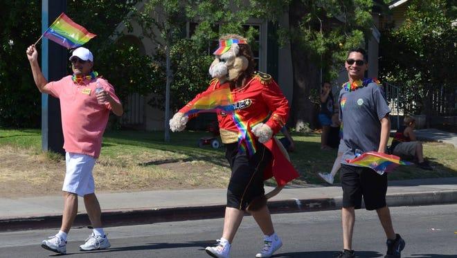 The Visalia Pride Lions Club mascot marches during the Fresno Pride Parade.