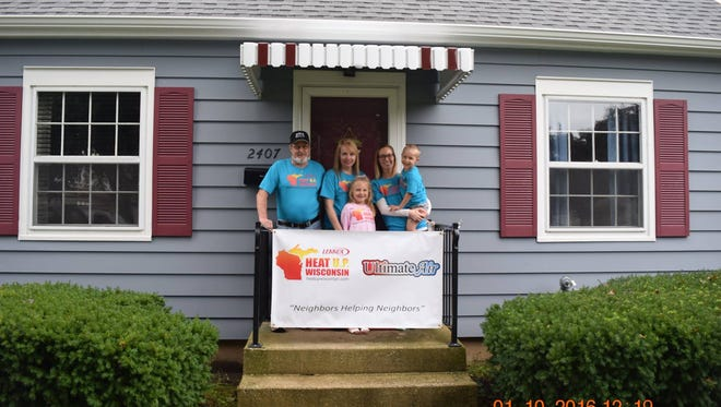 Crystal Brey (homeowner) with her children and her parents Randy and Tammi Brey.