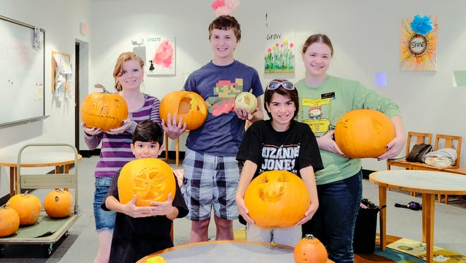 Participants at Germantown Library's pumpkin carving were Kat Walker (back row from left), John Walker and Michelle Hostetter and Noah Mahintorabi (front row from left) and Nina Mahintorabi.
