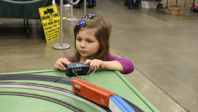 Jinna Angelo Kenney, 4, watches as her train whirls around the track.