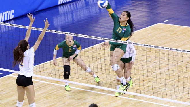 Diana Fa'amausili of Alaska-Anchorage spikes the ball past the defense of Morgan Seaton of Angelo State on Thursday at the NCAA DII tournament. Alaska-Anchorage won in four sets.
