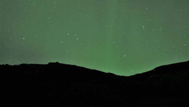 "For two nights in a row, Richard Hoben of Pineville was able to see the aurora borealis, or the northern lights, on a two-week trip to Iceland. ""That was amazing,"" he said. ""It just lit the whole sky up. It started off as a pinprick and then it would cover the sky."""
