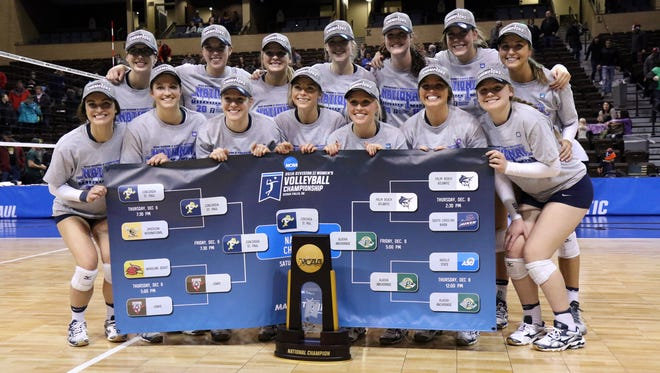 The 2016 NCAA DII National Champions Concordia-SP pose with the trophy after defeating Alaska Anchorage for the title on Saturday in Sioux Falls.