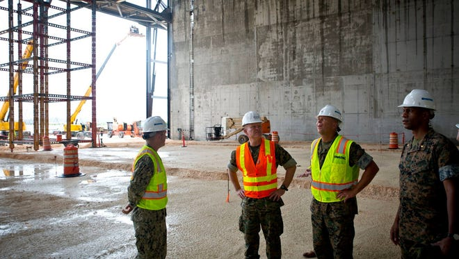 U.S. Marine Corps Lt. Gen. Lawrence Nicholson, Commanding General, III Marine Expeditionary Force Commander, Marine Forces Japan, on Jan. 11 takes a tour of the construction on the Air Combat Element Ramp. Lt. Gen. Nicholson made a visit to Guam to see the current and future facilities on the island. The planned relocation to move about 5,000 of the Okinawa-based Marines to Guam is part of a broader agreement between the U.S. and Japan governments to reduce the presence of about 18,000 Marines in Okinawa by nearly half, according to news file.