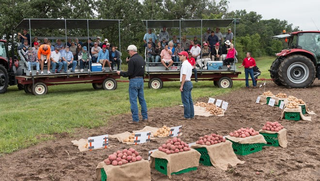 Researchers share their results of the potato harvest at the UW-Madison Hancock Agricultural Research Station.