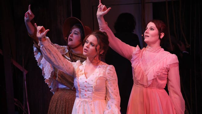 "Backdoor Theatre ""Big River"" cast members Jennifer Murphy, Amy Ray and Erin Sherry (from left) sing ""You Ought to Be Here With Me,"" which incorporates American Sign Language. The ""Big River"" cast spent about 2 1/2 months learning ASL for the show."
