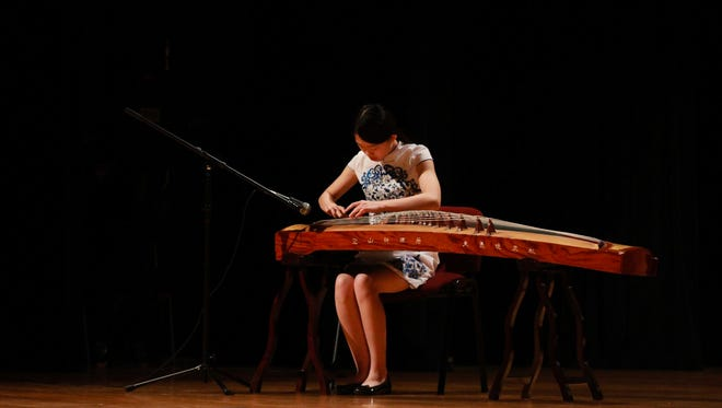 Wenxin Song playing the guzheng captured by Anna Wiman, Rickards student photographer