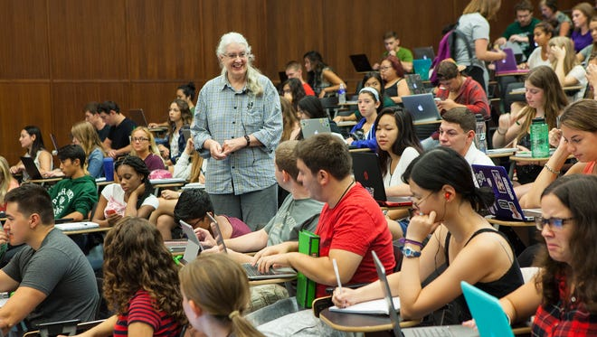 Binghamton University Lecturer Jeanne Lawless greets students before the start of Biology 118 on the first day of classes of the 2015-16 academic year.