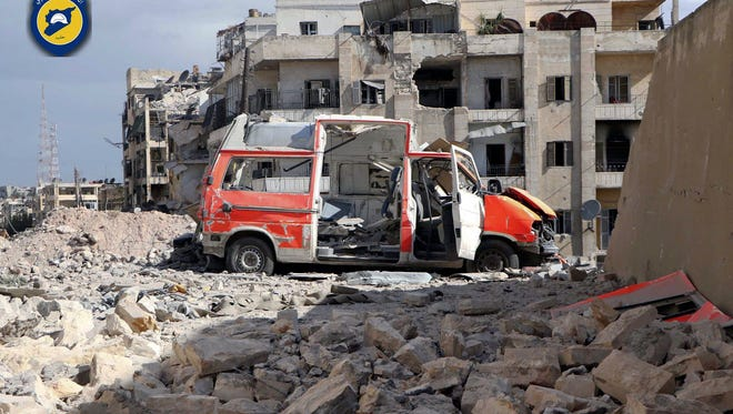FILE - In this photo provided by the Syrian Civil Defense group known as the White Helmets, taken Sept. 23, 2016, a destroyed ambulance is seen outside the Syrian Civil Defense main center after airstrikes in Ansari neighborhood in the rebel-held part of eastern Aleppo, Syria. The implosion of diplomatic talks with Russia has left the Obama administration with a series of bad options for what to do next in Syria. Despite harrowing scenes of violence in Aleppo and beyond, President Barack Obama is unlikely to approve any risky new strategy before handing the civil war over to his successor early next year. (Syrian Civil Defense White Helmets via AP)