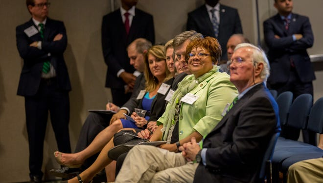 Green Tie Award recipients from right to left, Mack Pearsall, Erica Smith Ingram, Mike Woodard.