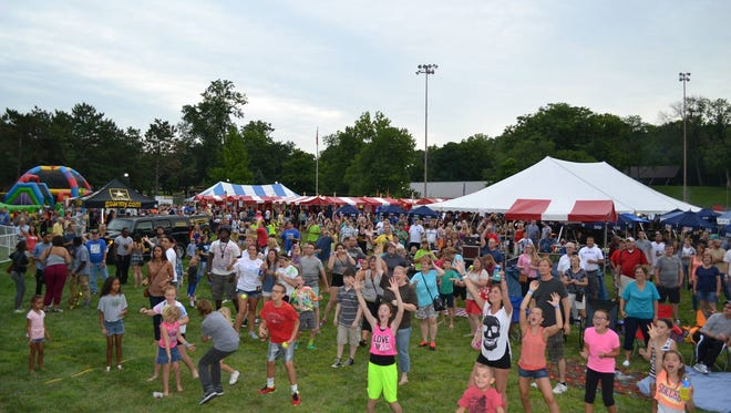 The SharonFest crowd hopes to catch the money ball during an event at last year's SharonFest.
