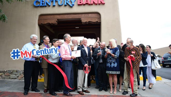 Employees and community leaders celebrate Century Bank's 130 anniversary at the downtown Santa Fe location.