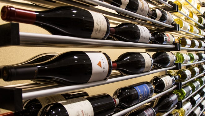 Rows of wine bottles lay on their sides at the House of Pure Vin to ensure that the cork remains wet and the wine well-preserved.