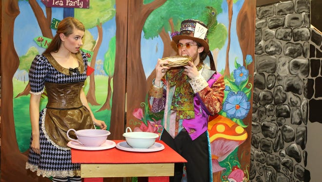 Alice (Carly Tizzano) meets the Mad Hatter (Daniel Melin).