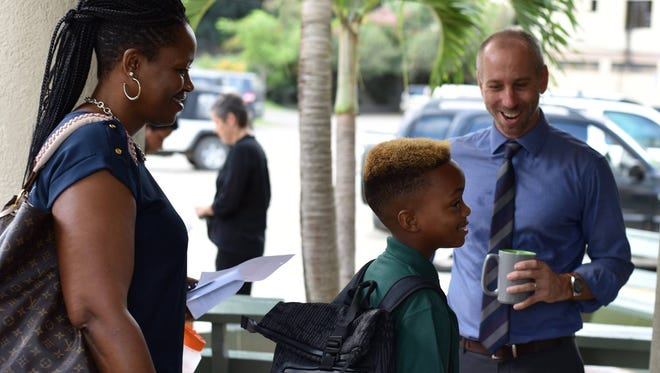 Scott Crawford, right, greets students at the Cedar International School the first day of the 2017-2018 school year. Crawford, a Lancaster native, now works on the island of Tortola in the British Virgin Islands. The island took a direct hit from Hurricane Irma.