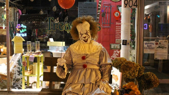 Pennywise the clown sits in downtown Manitowoc to promote the first Windigo Fest taking place on Franklin Street Oct. 6-7.