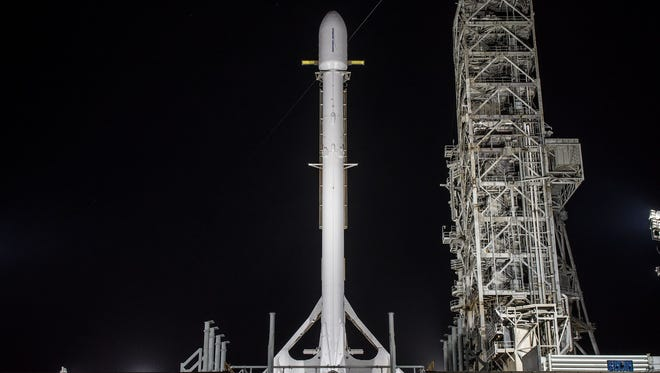 A SpaceX Falcon 9 rocket carrying the U.S. government's secret Zuma mission stands vertical on launch pad 39A at Kennedy Space Center.