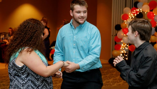 """Colby Ross (center), of Gleason, celebrates during Saturday's special needs prom at UT Martin with Rebekah Heidelberg, of Martin, and Richard """"Junior"""" Mewes, of Puryear. This marked the second year for the event."""