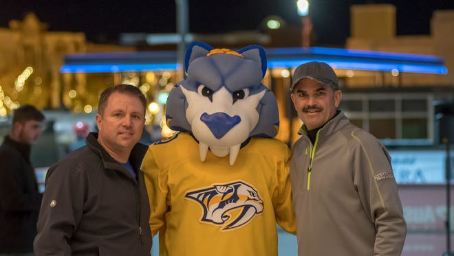 Norman Quirion, left, Nashville Predators mascot Gnash, and Charlie Koon during Montgomery County's opening night for ice skating at Downtown Commons on Friday in Clarksville.