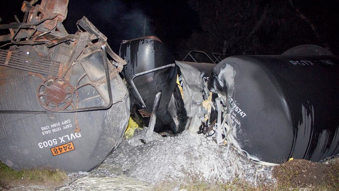 This photo made available by Polk County Fire Rescue shows molten sulfur that spilled from a derailed train near Lakeland, Fla., Monday, Nov. 27, 2017. State officials are investigating the crash.
