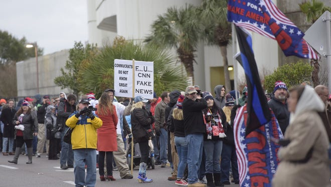Lines grow outside the Pensacola Bay Center in anticipation of President Trump's arrival on Dec. 8, 2017.