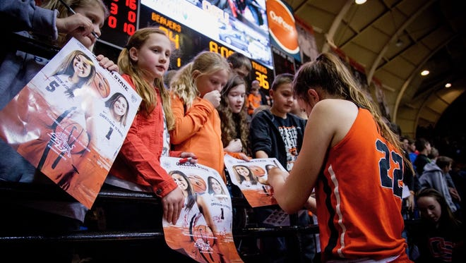 Oregon State women's basketball player Kat Tudor signs programs for Silver Falls School District students following the Beavers Beyond the Classroom game Wednesday, Dec. 13. Special to the Statesman Journal | Megan Lierman